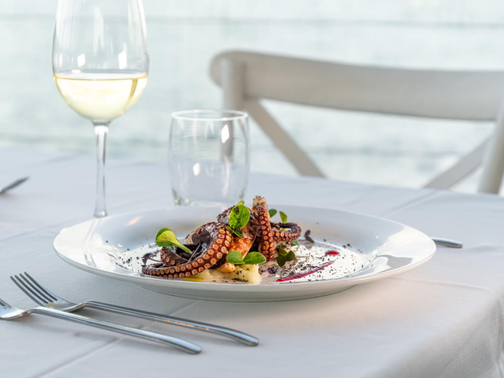 Roasted octopus with potatoes. Gourmet food. Italian traditional restaurant cuisine